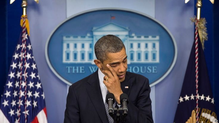 Barack Obama wipes away tears while commenting on the Connecticut shootings, Washington D.C., December 2012 (AP/ BBC News Online)