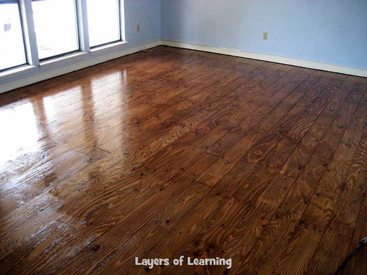 We installed real wood floors made from plywood in our living room, see what we did step by step (with pictures) plus a cost breakdown.