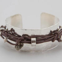 Silver bracelet with optional leather strap  Incredibly beautiful silver bracelets in three different widths and optional leather strap.  Width: 2.5 cm, 2 cm, 1.5 cm  Design and Crafts: Jenny Cederholm, VARIÉTÉ  From €197
