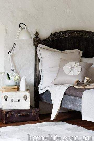 Stacking up old suitcases for a nightstand is not only a great alternative to the chunky table, but it also serves as storage for keepsakes.