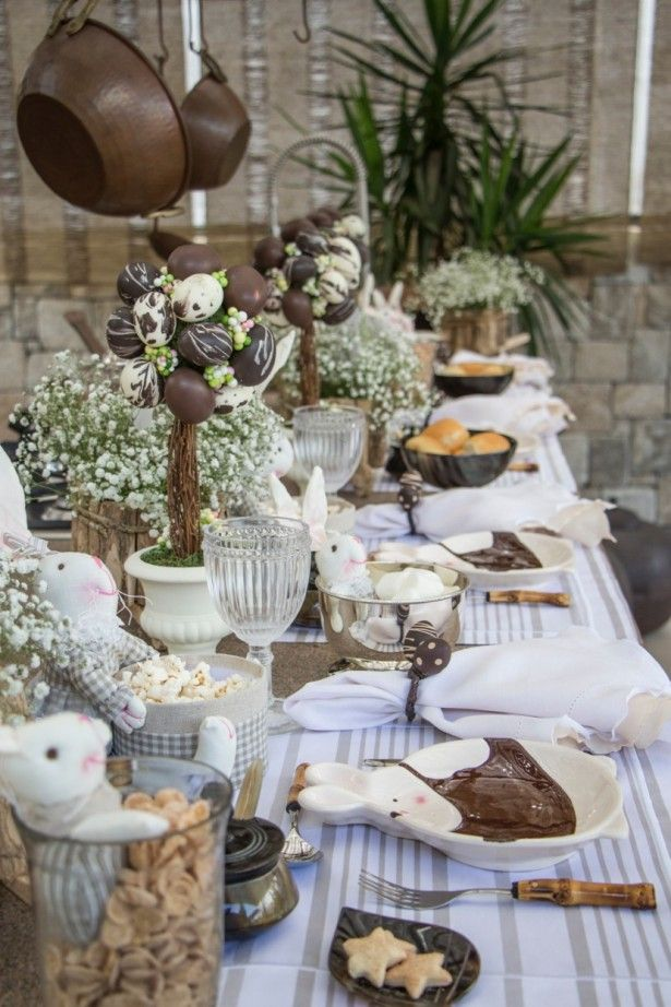I love so many things about this Easter table! What really grabs my attention is the chocolate egg topiaries with coordinating napkin rings. They look good enough to eat!