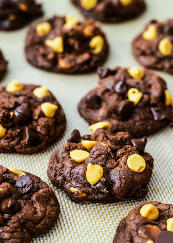 Super decadent and fudgy Death by Chocolate Cookies filled with chocolate chips and peanut butter chips.