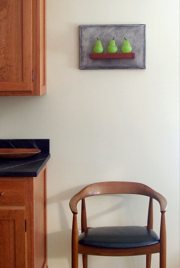 Art Glass, Vermont kitchen featuring 'Three Green Pears Still-Life' wall sculpture composed of hand blown glass pears, stainless steel and mahogany. Kitchen has shaker style cherry cabinets and soapstone countertops.