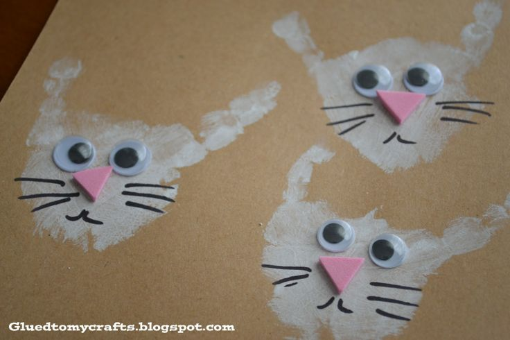 Handprints turned into bunnies-Bunny Prints-Jump Into Spring Craft series #toddler #crafts