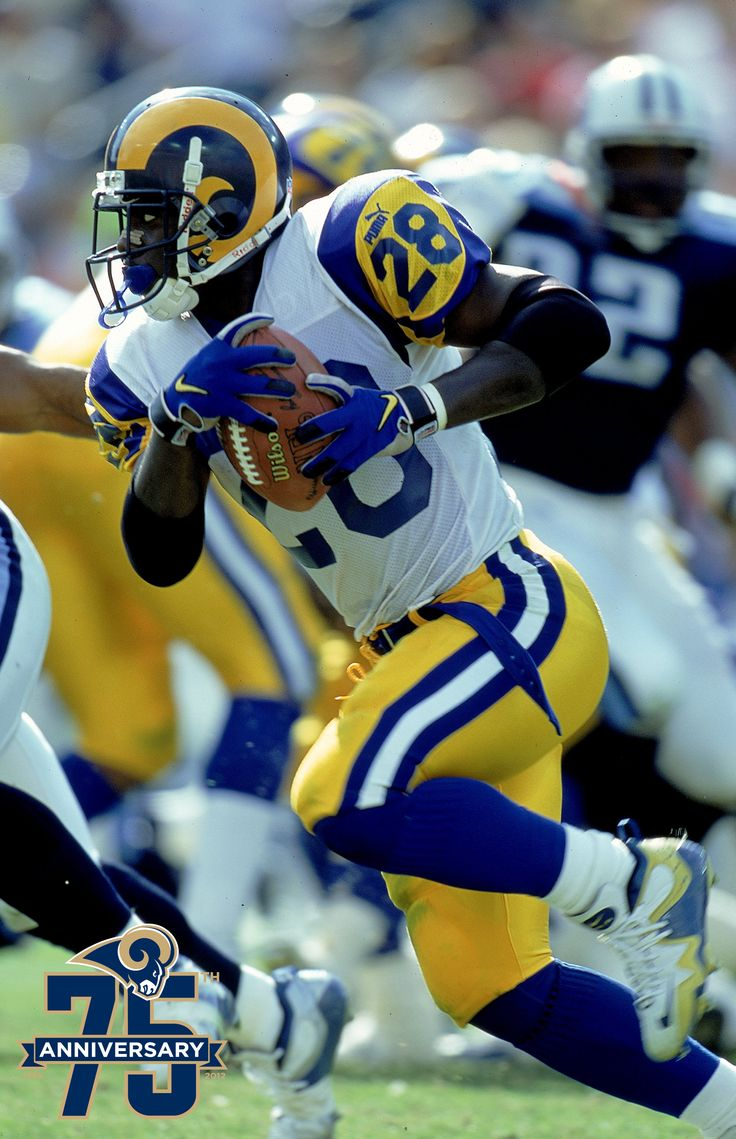 """Running back Marshall Faulk played for the St. Louis Rams from 1999-2005. Faulk was a major part of the Rams """"Greatest Show on Turf"""" era, tallying 6,959 rushing yards, 4,071 receiving yards and 80 touchdowns as a Ram. In his 12 season career Faulk was a three time All-Pro Selection (1999, 2000, 2001), a seven time Pro-Bowler (1999, 2000, 2001, 2002 with the Rams), won Super Bowl XXXIV, had his #28 retired by the Rams in 2007, and Faulk was inducted into the Pro Football Hall of Fame in 2011."""