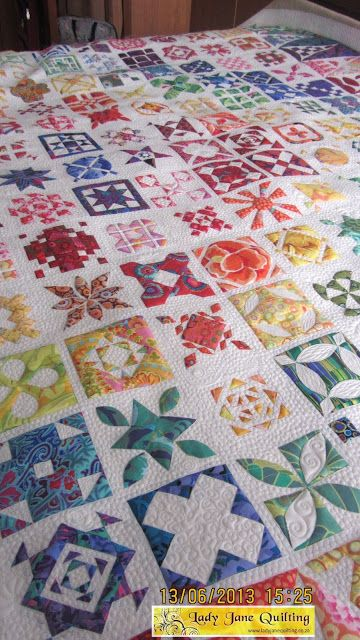 Sue's Dear Jane Quilt, quilted by Telene Jeffrey | Lady Jane Quilting.  100 plus hours of quilting, approx. 8000m thread.  The quilting was done on the white fabric only; she stitched in the ditch around all of the colored pieces