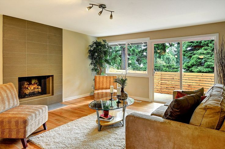 Cozy living room with built-in fireplace! Stylishly renovated home in Kirkland, WA.