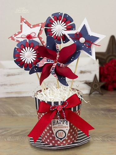 Check out this awesome July 4th centerpiece from Corri!  Such a cute idea!  The Flower Pot is from MOMS GARDEN GIFTS SVG KIT.  PATRIOTIC PARADE and MADE IN THE USA SVG KITS make up the flowers!   See that adorable Pinwheel?  It's free!  So generous of Mary and Leo, right!   Yep, you can find it here:  http://svgcuts.com/blog/2010/05/03/free-svg-file-sure-cuts-a-lot-05-03-10-deluxe-pinwheel/