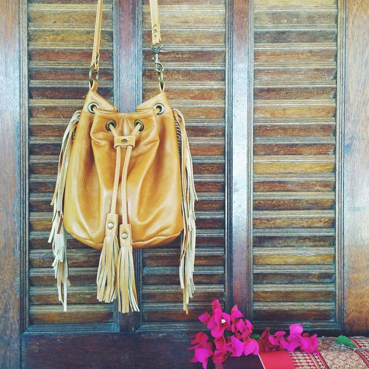 Fringed bucket bag in antiqued tan leather