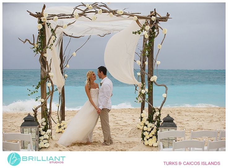 Rustic Arch with white roses - Wedding at Grace Bay Club - Brilliant Studios