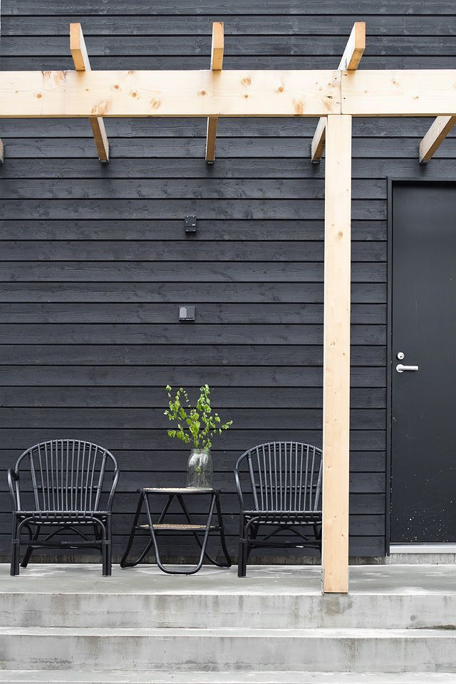black exterior, natural wood