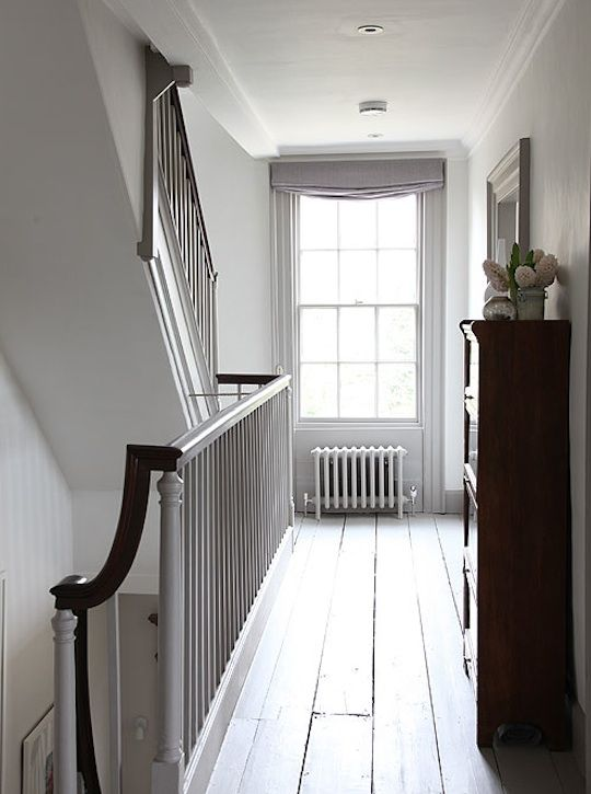 Grey-painted hallways in French gray Dark paint from The Little Greene Co.accenting the white interiors