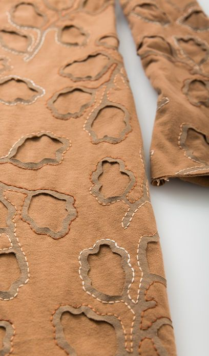 Patterned fabric, reverse applique, variegated embroidery thread, subtle shading. Gorgeous!