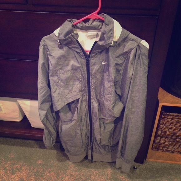 Nike rain jacket Womens medium. Charcoal grey Nike rain jacket with lining! Worn a few times Nike Jackets & Coats