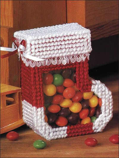 "Christmas Candy Boxes - Fill these elf-size boxes with holiday goodies. This e-pattern was originally published in Santa Surprises.   Size: Stocking Candy Box: 3 1/2"" x 4 1/4"" x 1 3/8"". Gift Candy Box: 3 3/4"" x 5 7/8"" x 1 5/8"". Made with medium (worsted) weight yarn and 7-count plastic canvas.  ITEM #EP00216	PRICE: $2.69"
