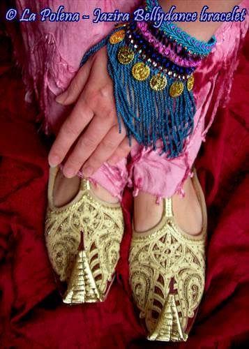 https://flic.kr/p/Pf4ZTG   Jazira belly dance bracelet   Wrist wrap textile bracelet, hand dyed vintage fringe, lot of coins.