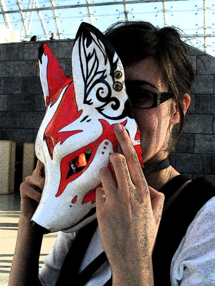 Beautiful kitsune mask being equipped by a westerner  (lillylongleg on deviantART, 2011)