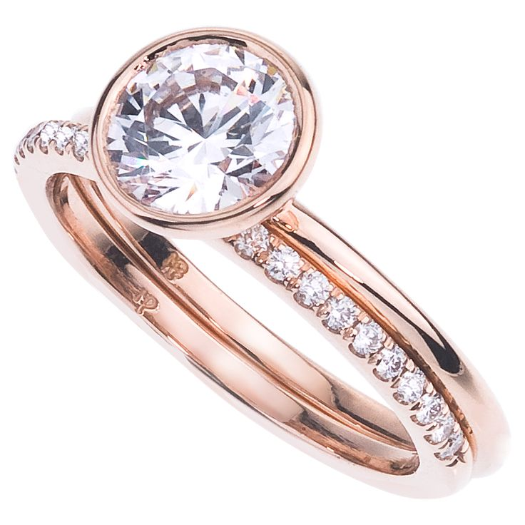 This 18 karat rose gold bezel set solitare is the perfect choice for stacking with different color metal bands.