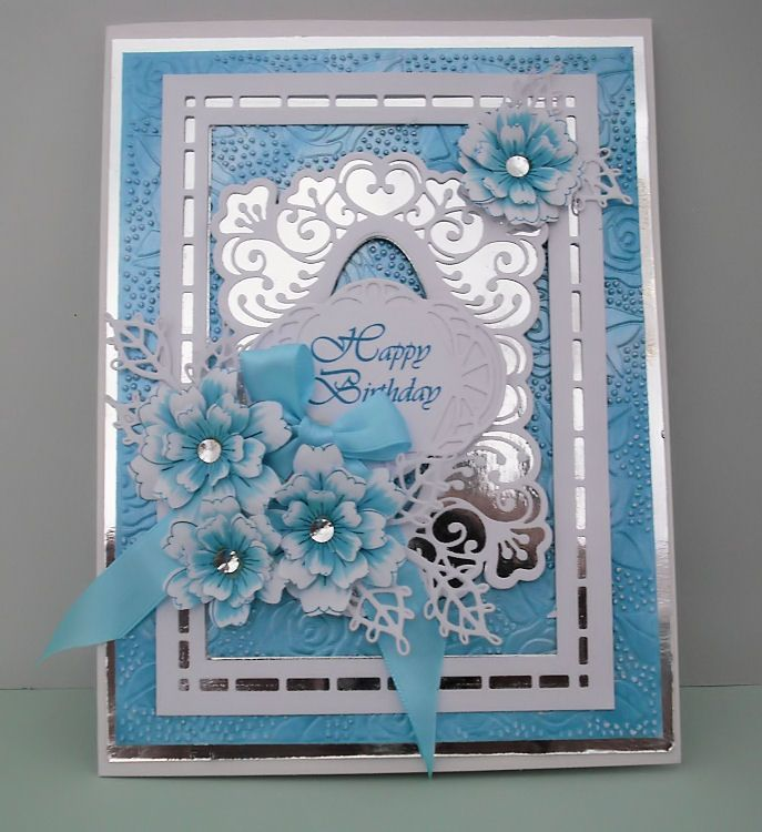 ....by Marjorie Ramsay...Rose Blooms embossing folder...Ocean Teal & Pearl Lustre gilding polish....Lauren frames & tags......Australian background....Portuguese tag...Lace Edged Leaves....FSS flowers..and computer generated greeting.