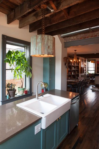 Eclectic kitchen ..Love this farmhouse sink & reclaimed wood light fixture .