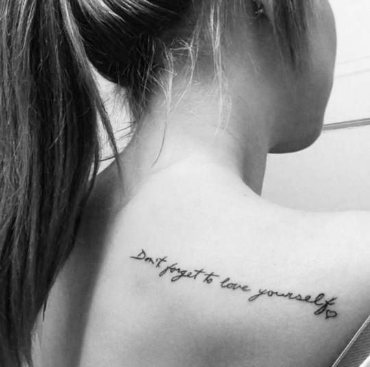"Shoulder tattoo saying ""Don't forget to love yourself"" followed by a heart on Devon Mullenbach."
