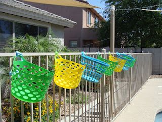 Organizing stuff by the pool, great idea for kids pool toys, flippers and goggles and more !!