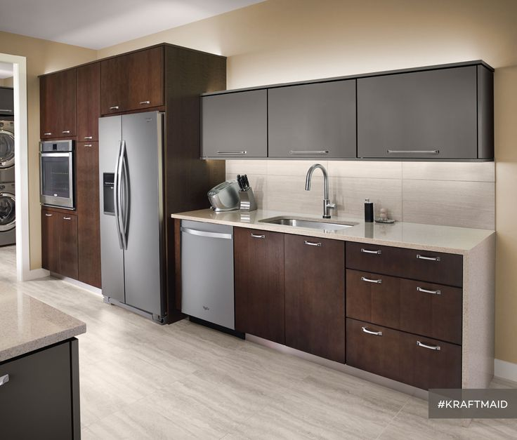 This kitchen features quartersawn cherry cabinet doors with a ...