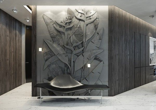 One of the most unique features in this room is the stunning carved walls, which feature birds of paradise flowers in stark relief.
