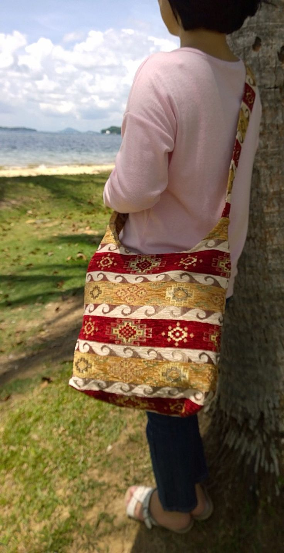 A personal favorite from my Etsy shop https://www.etsy.com/listing/229620904/silk-embroidery-crossbody-bag-boho-folk