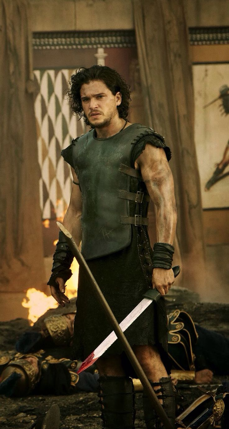 "Kit Harrington in ""Game of Thrones.""<<< No, this is Kit Harrington in ""Pompeii"" if this was Game of Thrones he would NOT wear short sleeves!"
