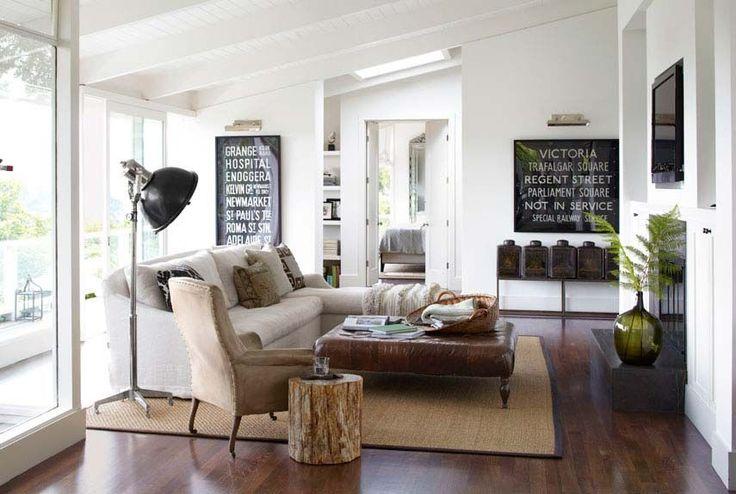 Fantastic London bus signs and 19th-century tea tins. #livingroom #decorating