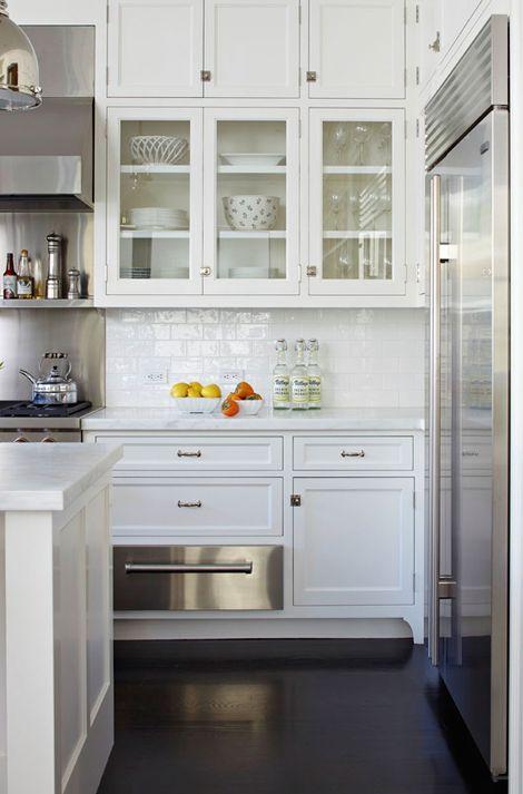 White subway tile, dark floor, recessed fridge