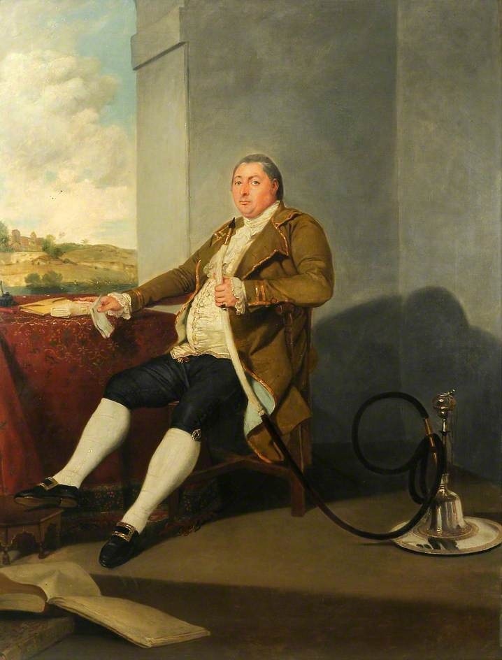 James Graham of Barrock Park and Rickerby, 1786, by Johann Zoffany. A full-length portrait of James Graham (1747–1820) seated, holding a fine silver hookah for smoking tobacco. He is smartly and expensively dressed. His vast girth is a result of him enjoying many large dinners in India. A landscape fringed with palm trees can be viewed through a window opening on the left of the composition. In 1780 at the age of 33 he went to India to seek his fortune and worked for the East India Company.