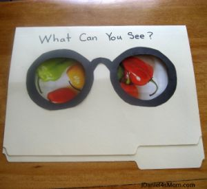 """Search Glasses: Hide target words (animals, clothing, colors) by taping them to wall under black paper. Use special glasses to search. """"I see..."""""""