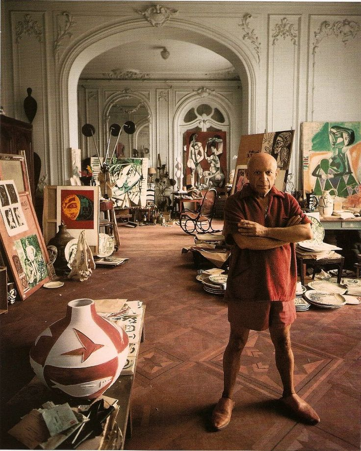 Pablo Picasso who was born today in 1881. Here he is in his Cannes studio in 1956 in a photograph taken by Arnold Newman.