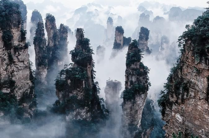 Private 5-Day Tour Combo Package: Zhangjiajie Exploration Including Tianmen Mountain and Fenghuang Visitthe most impressiveattractions of Zhangjiajie, including Zhangjiajie Grand Canyon, Baofeng Lake, Yuanjiajie Mountain, Bailong Elevator, Tianzi Mountain, Ten-mile Natural Gallery and fenghuang, where you can explore the authentic elementsof this World Heritage Site. This is a multi-day tour package only, no hotel accommodation and airfare included. Note: Your meeting and d...