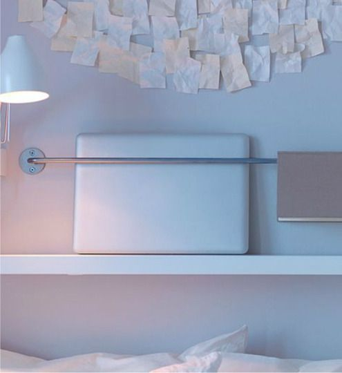 In a small space, vertical storage can be a life saver. I never would have thought of this - a BYGEL rail and small shelf becomes an easy bedside laptop holder.