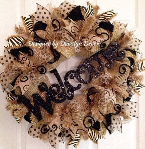 Welcome your guests with this full and unique deco mesh burlap wreath with animal print, polkadot, and scroll wired ribbon for easy reshaping.