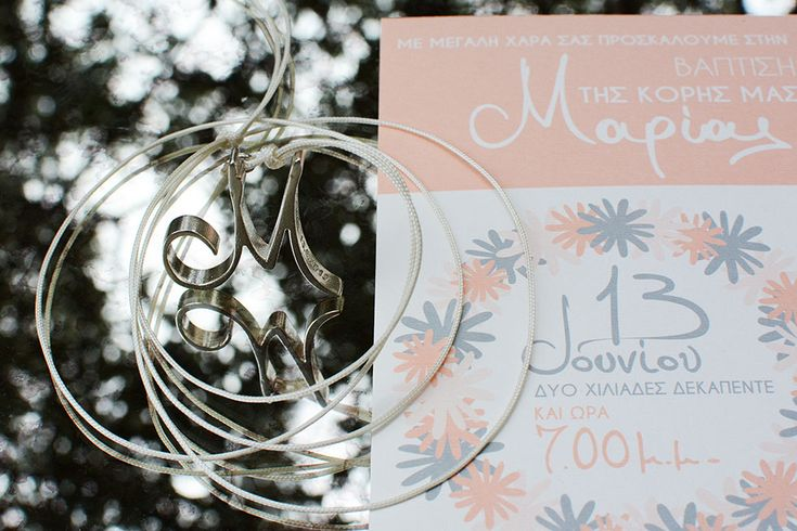 Cute, childlike 3D printed monogram in pure silver derived from the design of the invitation card