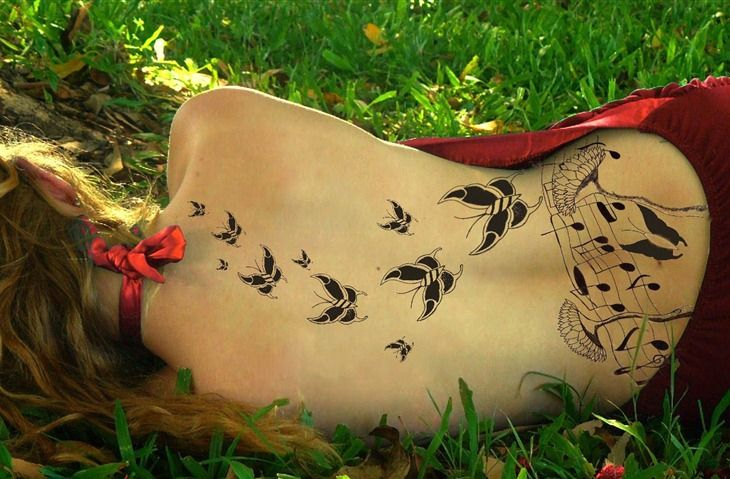 Tattoos shooting star   Cool Music And Butterfly Back Tattoo Design Cool Tattoo