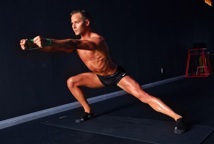 Jason Wimberly is way more than an oiled six pack. Here's how to stand with the trainer's level of poise and confidence, Barbie arches not required.