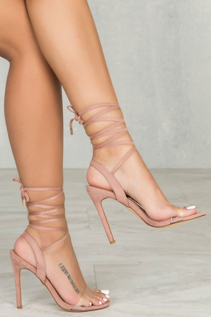Your basic lace up heel with a added touch. The Ariana features a clear toe strap with adjustable laces. - Fits true to size for most - 4.25 inch heel - Suede like material