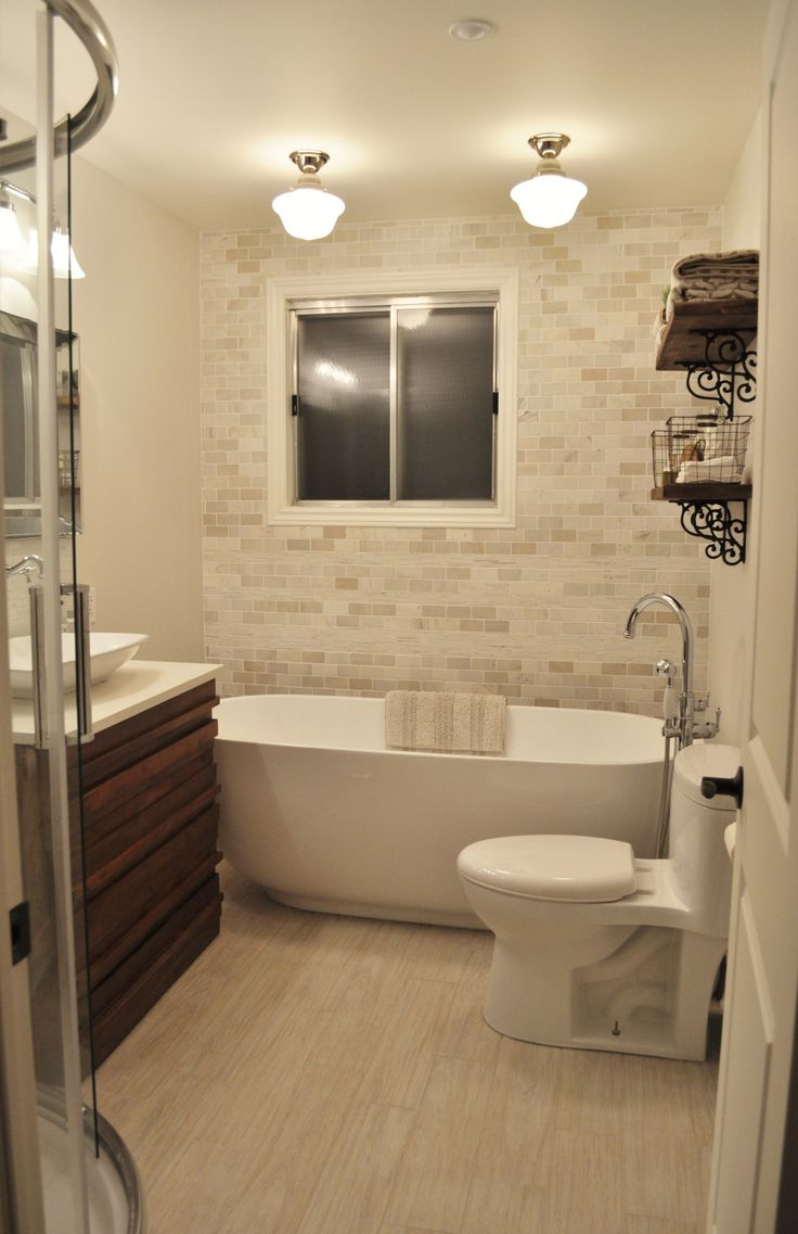 Love the subway tile up the wall