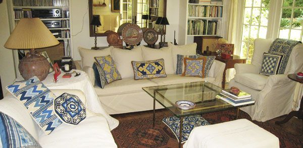 a collection of cross-point pillows in blue, white and yellow