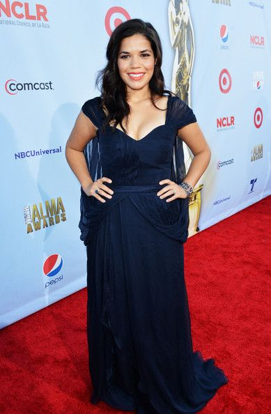 American dream!   America Ferrera looks stunning in this navy blue number. If you want to hide your upper arms, follow her lead and try a flattering cap sleeve.