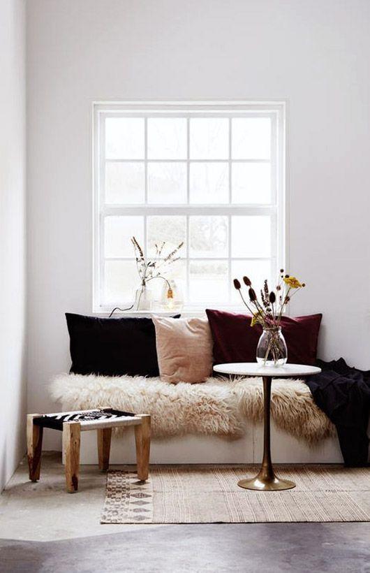 fur draped bench with velvet pillows. / sfgirlbybay