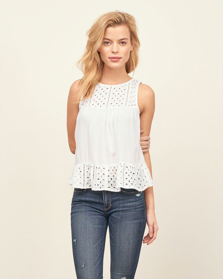 Supersoft and pretty with a swingy silhouette, eyelet paneling, ruffle hem and eyelet at back, Easy Fit, Imported