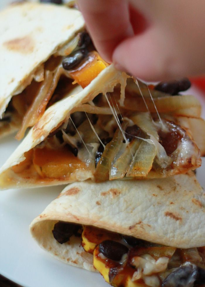 Smoky Delicata Squash & Black Bean Baked Quesadillas - Spicy seared delicata squash, blackened onions, black beans, and pepper jack, tucked inside a tortilla and baked until melty and golden. Serve with a little pico de gallo or fresh tomato slices and di
