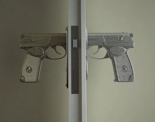 Bang Bang door handle - how cute for a boys room!  Or the man cave.