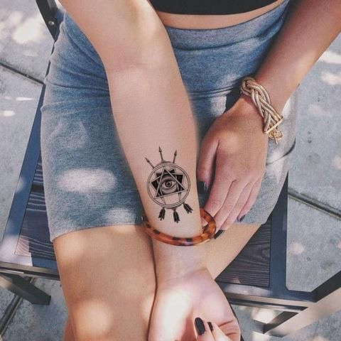 Minimal Arrow Wrist Tattoo Ideas for Women - MyBodiArt.com - Tribal Evil Eye Arm Tatt